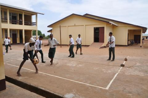 Children playing football in a school yard